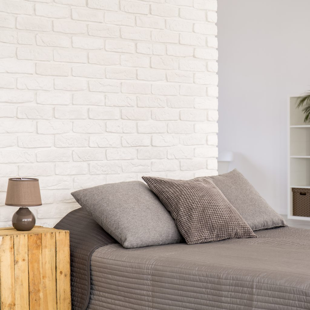 White brick wall in new modern bedroom